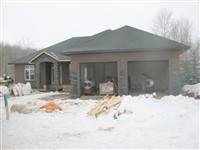 Full system acrylic applied to this house in Athabasca